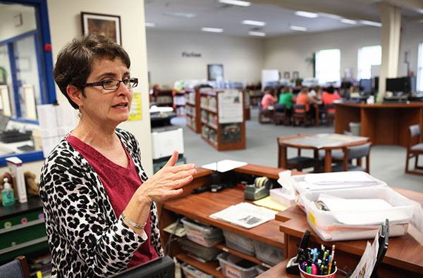 Media Coordinator Lynn Routh at Randleman Elementary in Randleman, NC, prepares for another school year. Routh has lost her assistant amid budget cuts from the 2013-2014 state legislative session.