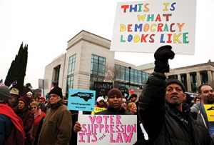 """""""What democracy looks like"""" — Demonstrators gather in Raleigh during the 2014 """"Historic Thousands on Jones Street"""" rally. (Photo by Ricky Leung)"""