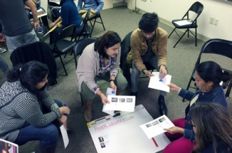 Iliana Santillán-Carrillo, of El Pueblo, works with members of Raleigh's immigration community to teach the basics of North Carolina and federal law at a meeting Monday. (Photos by Melissa Boughton.)