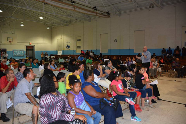 ... Eric Hall addresses more than 100 parents and community members at  Southside Ashpole Elementary. (Photo: Public Schools of Robeson County)